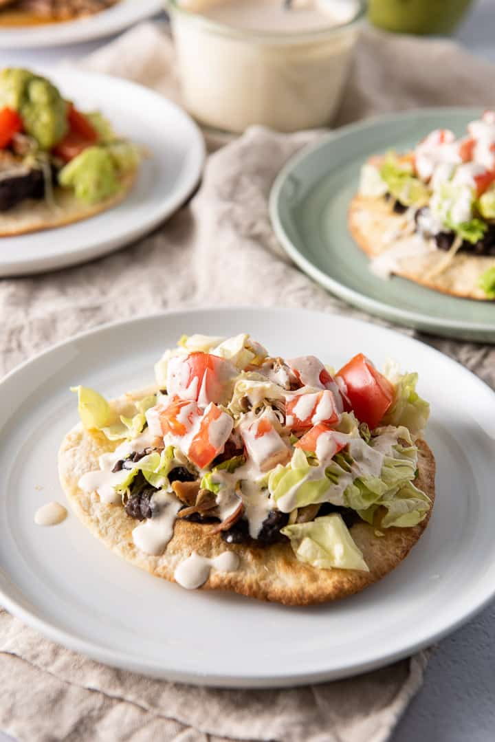Close up of a pork tostadas with crema on top