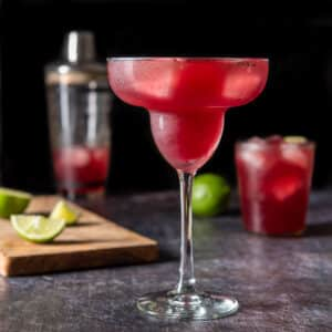 Margarita glass filled with pomegranate margarita - square