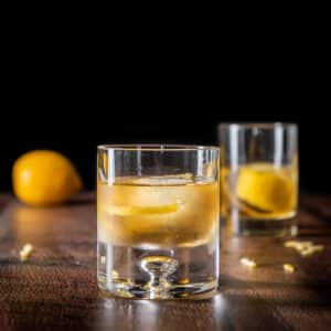Two glasses of the rusty nail cocktail - square